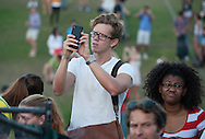 CAPE TOWN, SOUTH AFRICA - Thursday 9 April 2015, a student takes pictures during the removal of the statue of CECIL JOHN RHODES at the University of Cape Town. Rhodes (5 July 1853 &ndash; 26 March 1902) was a British businessman, mining magnate, and politician in South Africa. An ardent believer in British colonialism, Rhodes was the founder of the southern African territory of Rhodesia, which was named after him in 1895. South Africa's Rhodes University is also named after Rhodes. He set up the provisions of the Rhodes Scholarship, which is funded by his estate. <br /> Photo by Roger Sedres/ ImageSA