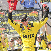 Joey Logano (22) creates a celebration for photographers after winning the NASCAR Nationwide Series 5-HOUR ENERGY 200 auto race at Dover International Speedway in Dover, DE., Saturday,  June 01, 2013.