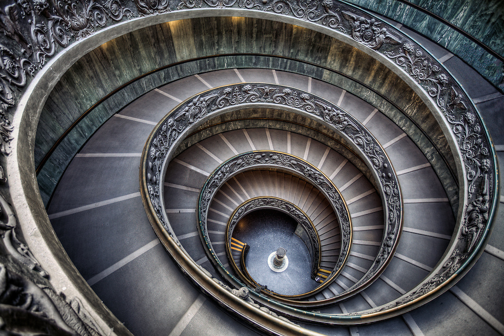 The Bramante Staircase is a double helix staircase designed by Giuseppe Momo in 1932 and it features granite doric columns and a herringbone paving pattern. A canopy located above provides the necessary light to illuminate the stairs. The staircase is located at the end of the museum visit and all visitors leave by this route, so you definitely don't need to worry about missing it.