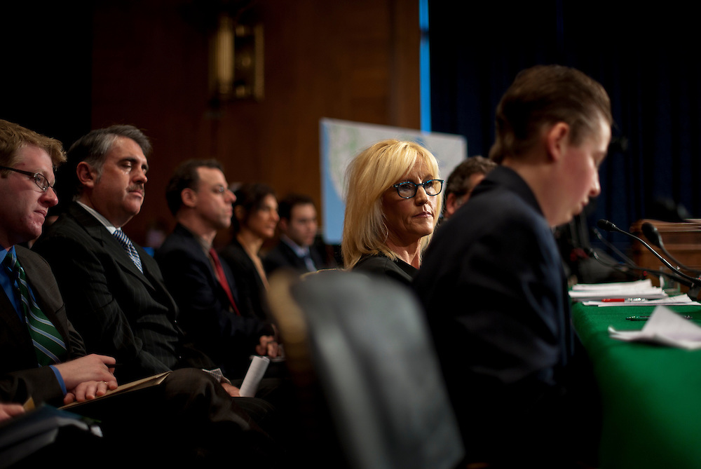 """Erin Brockovich listens as Trevor Schaefer, youth ambassador and founder of Trevor's Trek Foundation testifies during an Environment and Public Works Committee hearing on """"Disease Clusters and Environmental Health."""""""