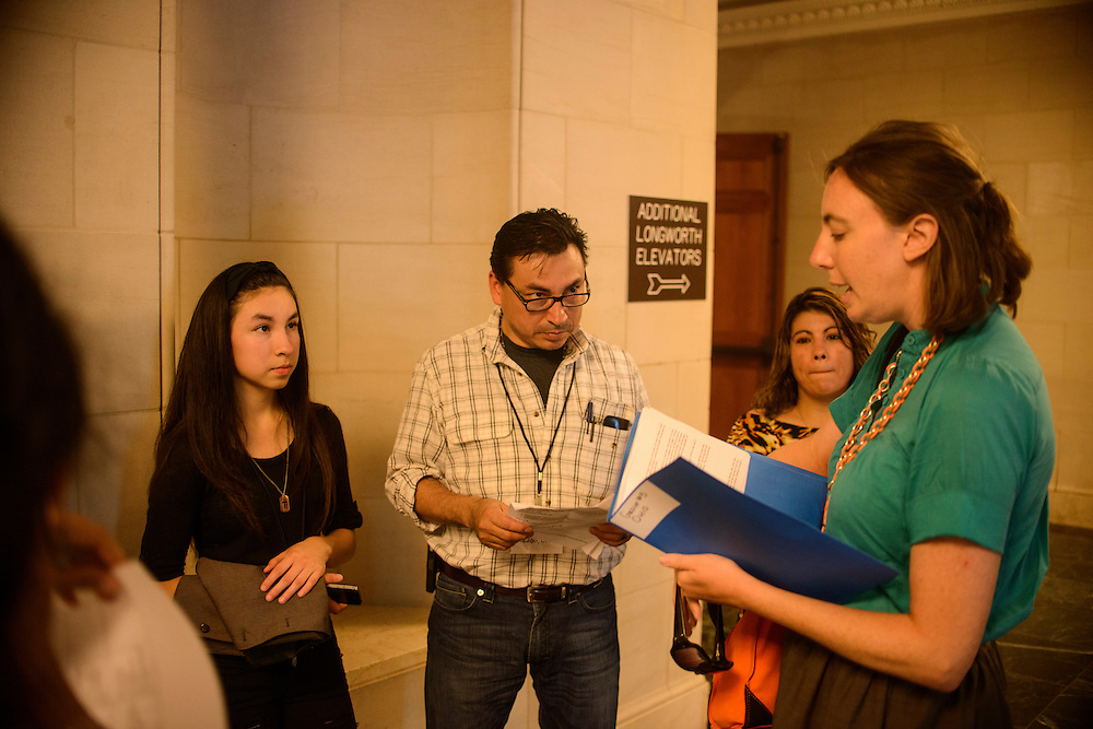 Photo by Matt Roth<br /> <br /> Farmworker Justice Migrant Health Policy Analyst Alexis Guild preps Ohio constituents Mario Vargas, a farmworker organizer from Ohio, his daughter Myra Vargas, and Leticia Vargas at Longworth house office building before their meeting with John Crown, Legislative Assistant in Senator Sherrod Brown during the Farmworker Fly In event in Washington, D.C. on Tuesday, July 16, 2013.