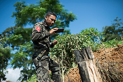 Laiza 20160915<br /> A K.I.A. strategist is documenting the impact site after the Burmese army shellings of Tsin Yu Bum, a mountain top with a frontline outpost, near Laiza, Kachin State, Myanmar.<br /> Photo: Vilhelm Stokstad / Kontinent