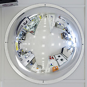 A security mirror on the ceiling of a research facility