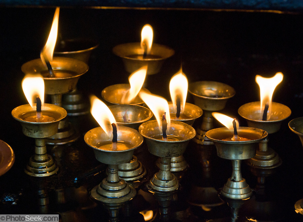 "Candles make a religious offering at Buddhist Swayambhunath, the ""Monkey Temple"", founded about 500 AD, one of the oldest and holiest Buddhist sites in the Kathmandu Valley, Nepal. Swayambhunath sits on a hill in the west of Kathmandu overlooking the city."