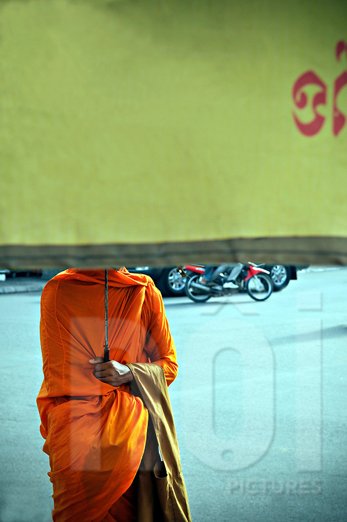 Buddhist monks stands on street of Phnom Penh, Cambodia, Southeast Asia