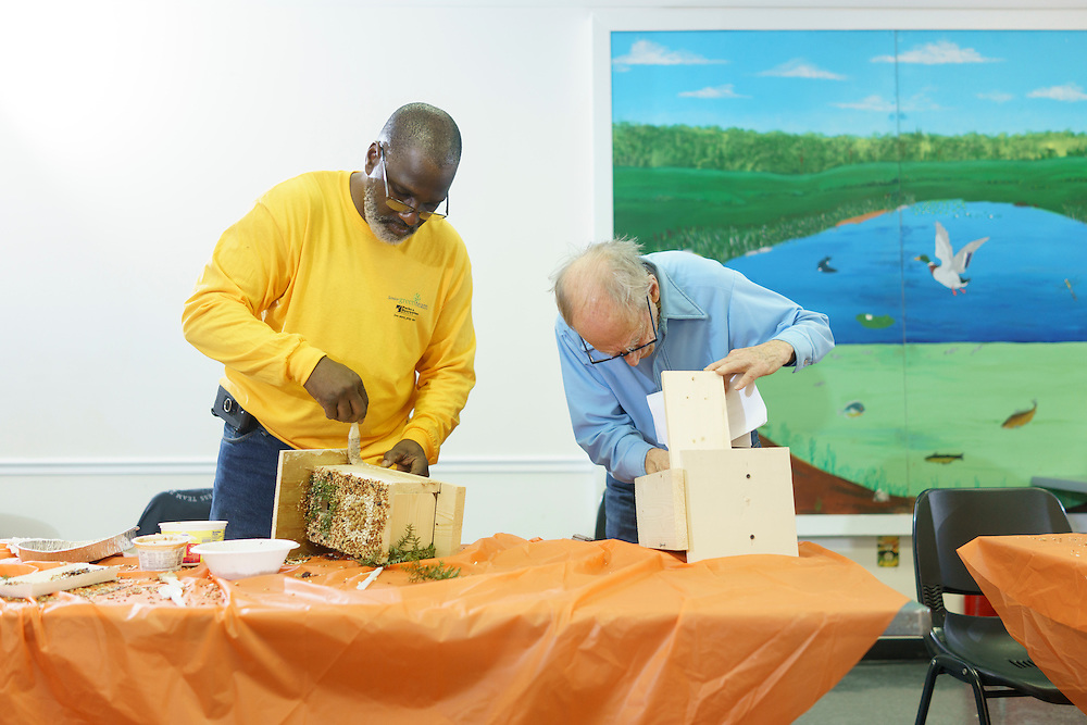 Upper Marlboro, Maryland - January 03, 2017: Fletcher James and George Morton, members of the Senior Green Team build and decorate birdhouses at the Watkins Park Nature Center in Upper Marlboro, Md., Tuesday January 3, 2017. The group meets the first Tuesday morning of each month and works on nature beautification projects like trail maintenance, tree planting, clean ups, and, educational outings. <br /> <br /> CREDIT: Matt Roth