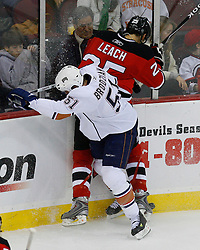 Nov 9, 2008; Newark, NJ, USA; Edmonton Oilers center Kyle Brodziak (51) hits New Jersey Devils defenseman Jay Leach (25) during the second period at the Prudential Center.