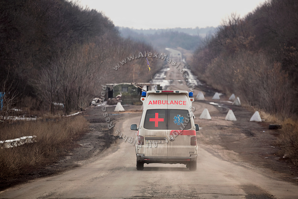 Julia Paevska's ambulance is travelling towards a checkpoint set up by the army on the road between Bakhmut and Luhanske, near the frontline in eastern Ukraine.