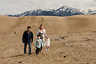 Family, walking, foothills of Absaroka Mountains, southwest of Livingston, Montana, Holliday Family