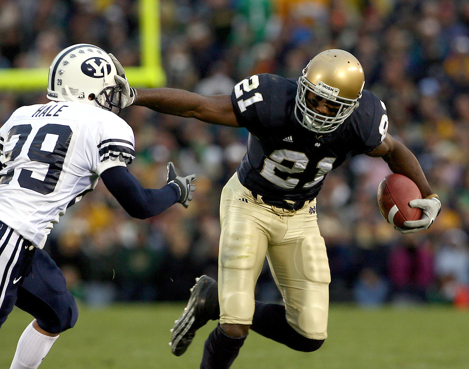 Oct. 16, 2005; South Bend, IN, USA; Notre Dame Fighting Irish wide receiver Maurice Stovall stiff-arms Brigham Young University Cougars defensive back Chris Hale on his way to the end zone Saturday Oct. 22 at Notre Dame Stadium. Notre Dame won 49-23. Mandatory Credit: Photo By Matt Cashore-US PRESSWIRE Copyright (c) 2005 Matt Cashore