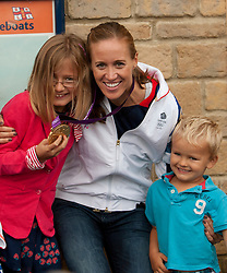 © Licensed to London News Pictures. 19/08/2012. Penzance, UK. Helen Glover, the first winner of a Gold Medal at 2012 London Olympic games for Team GB poses for photographs with children ahead of her parade through the streets of her home town. Photo credit: Ashley Hugo/LNP