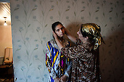 Safargul's mother Dastargul caresses her daughter and strokes her hair before before posing for a photo together. <br /> Now 13 years old, mentally challenged girl Safargul has MDR TB as well as having occasional epilepsy attacks further complicating her treatment. <br /> Safargul's mother is taking care of her daughters dot's (Direct Observed Treatment) and makes sure she takes her medicines. <br /> While being in a complicated home situation with her husband taking on a second wife and threatening to keep Safargul in case she seeks a divorce, she tries to find a way to get herself and Safargul out of this stressful home situation.