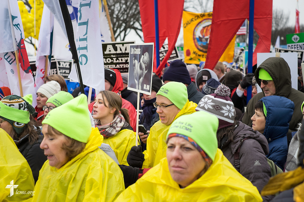 Second row, Stephanie Neugebauer, director of LCMS Life and Health Ministries, and the Rev. Christopher Esget, LCMS sixth vice-president and pastor of Immanuel Evangelical-Lutheran Church in Alexandria, Va., walk with others during the March for Life on Friday, Jan. 22, 2016, in Washington, D.C. Michael Schuermann for LCMS Communications