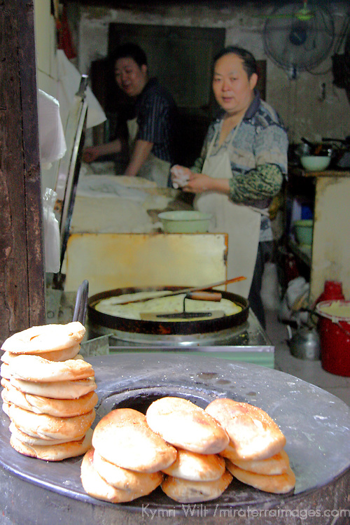 Asia, China, Chongqing. Fresh baked local bread in street market in the city of Chongqing.