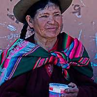 """Cusco , Peru - May 27 : Peruvian woman drink """"Chicha""""  , """"Chicha"""" is drink common throughout Latin America originated with the Incas , the photo was taken in Cusco Peru on May 27 2011"""