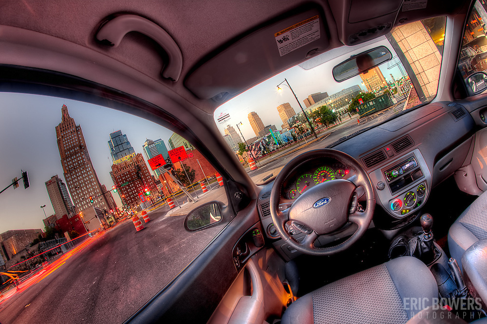 Fisheye lens view from the back seat of my car of the Kansas City skyline while parked along Baltimore near Truman.
