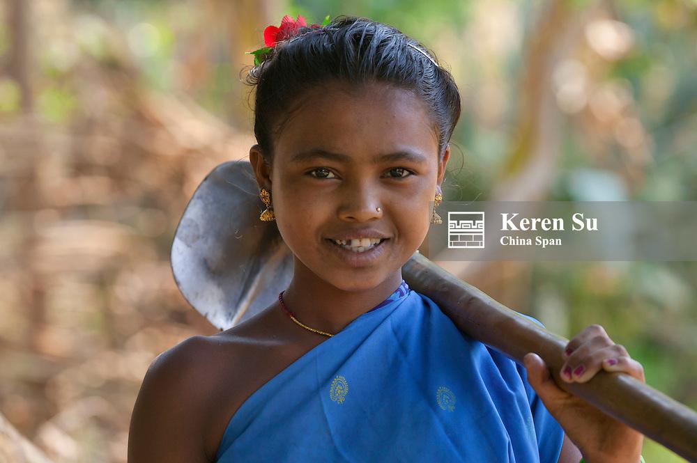 Hill tribesgirl carrying hoe, Orissa, India