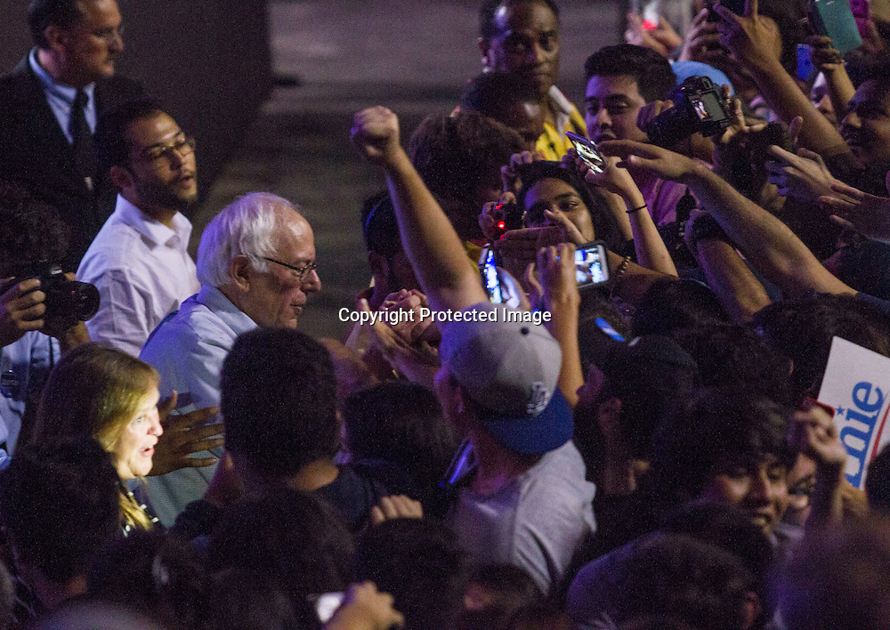 Democratic presidential candidate Sen. Bernie Sanders, I-Vt., greets his supporters at a rally, Monday, Aug. 10, 2015, at the Los Angeles Memorial Sports Arena in Los Angeles. (AP Photo/Ringo H.W. Chiu)