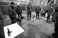 Farmers have joined together in a horse stable for a Gammel Dansk (a bitters liquor) before going hunting in the countryside of the Danish island Funen on sunday  17. November 2002.  Photo: Erik Luntang