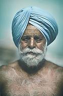 Sikh man wearing a turquoise 'dastar', Punjab, India.