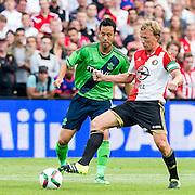 EINDHOVEN - Feyenoord - Southampton FC , Voetbal , Voorbereiding , Oefenwedstrijd , Seizoen 2015/2016 , Stadion de Kuip , 23-07-2015 , Southampton speler Maya Yoshida (l) in duel met Speler van Feyenoord Dirk Kuyt (r)