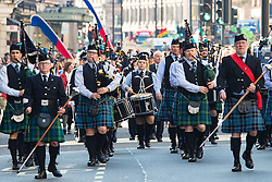 London, March 13th 2016. The annual St Patrick's Day Parade takes place in the Capital with various groups from the Irish community as well as contingents from other ethnicities taking part in a procession from Green Park to Trafalgar Square.  PICTURED: A pipe band marches along Piccadilly. &copy;Paul Davey<br /> FOR LICENCING CONTACT: Paul Davey +44 (0) 7966 016 296 paul@pauldaveycreative.co.uk