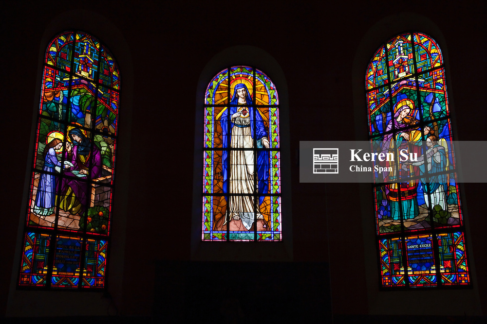 Stained glass window in Dalat Catholic church.