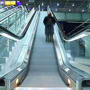 person climbing on escalator
