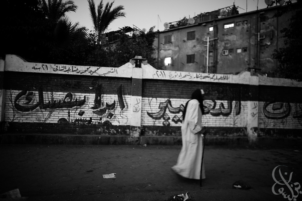 An Egyptian man walks past a mural celebrating the Jan 25 Revolution on a street in the Matareya district of Cairo, Egypt July 27,2011.  (Photo by Scott Nelson for Stern)