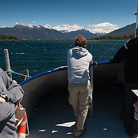 Passengers aboard the ferry crossing Lake Te Anau to begin the famous Milford Track, Fiordland, New Zealand
