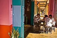 a group having tea outside a Kuching teahouse