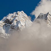 "Sagarmatha National Park: This is the north side of Ama Dablam, a beautiful mountain in the Himalaya range of eastern Nepal, in the Khumbu District. This was photographed between Dingboche and Chhukhung, in the Imja Khola river valley. Ama Dablam was first climbed in 1961. The main peak is 22,349 feet (or 6,812 meters) tall, and the lower western peak is 18,251 feet (or 5,563 meters). Ama Dablam means ""Mother and Pearl Necklace"" (the pearl being the perennial hanging glacier)."