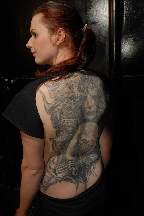 New York City Tattoo Convention 2009 at the Roseland Ballroom: Chelsea Palmer with work by Swiss artist Rene Meir from Thun in Switzerland.