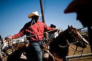 A cowboy adjusts his lasso during the the annual rodeo on the Tohono O'odham Native American reservation in Sells, Arizona, on Saturday, Feb. 2, 2008. The rodeo has been taking place for 70 years and is the largest Indian rodeo in Arizona.
