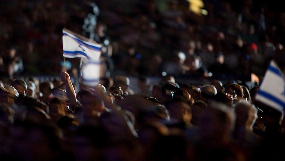 Participants in the Walk for Israel in Toronto, Ontario, Canada,  wave Israeli flags during a speach by Israeli Prime Minister Benjamin Netanyahu May 30, 2010. The prime minister is on a state visit to Canada, the first for an Israeli leader in 16 years.<br /> AFP/GEOFF ROBINS/STR