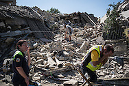 Rescuers resting after digging in the debries of the many houses destroyed by the earthquake. A 6,4 earthquake has hit central Italy during the night between the 23 and 24 August killing more than 100. The town of Amatrice is been heavily damaged.