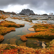 Storm clouds allow a glimpse of Prusik Peak during a hike in The Enchantment Lakes Basin in Washington State on October 8, 2004..Photo by Joshua Trujillo / Seattle Post-Intelligencer.