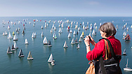 A spectator photographs the fleet from the cliffs above The Needles during the J P Morgan Asset Management Round The Island Race. PRESS ASSOCIATION Photo. Picture date: Saturday June 21, 2014. 1,600 yachts of all sizes competed in the 50 nautical mile race around the Isle of Wight which was first run in 1931. It is the 83rd time the race has been held and it is the fourth largest participation event in the UK after the London Marathon and the Great North and South Runs. Photo credit should read: Chris Ison/PA Wire.
