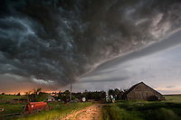 A squall line passes over a farm in central Kansas, May 26, 2006.
