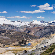 See a panorama of Cordillera Raura (18,757 ft / 5717 m) from Punta Cuyoc in the Cordillera Huayhuash in the Andes Mountains, Peru, South America. Day 5 of 9 days trekking around the Cordillera Huayhuash. This panorama was stitched from 2 overlapping photos.