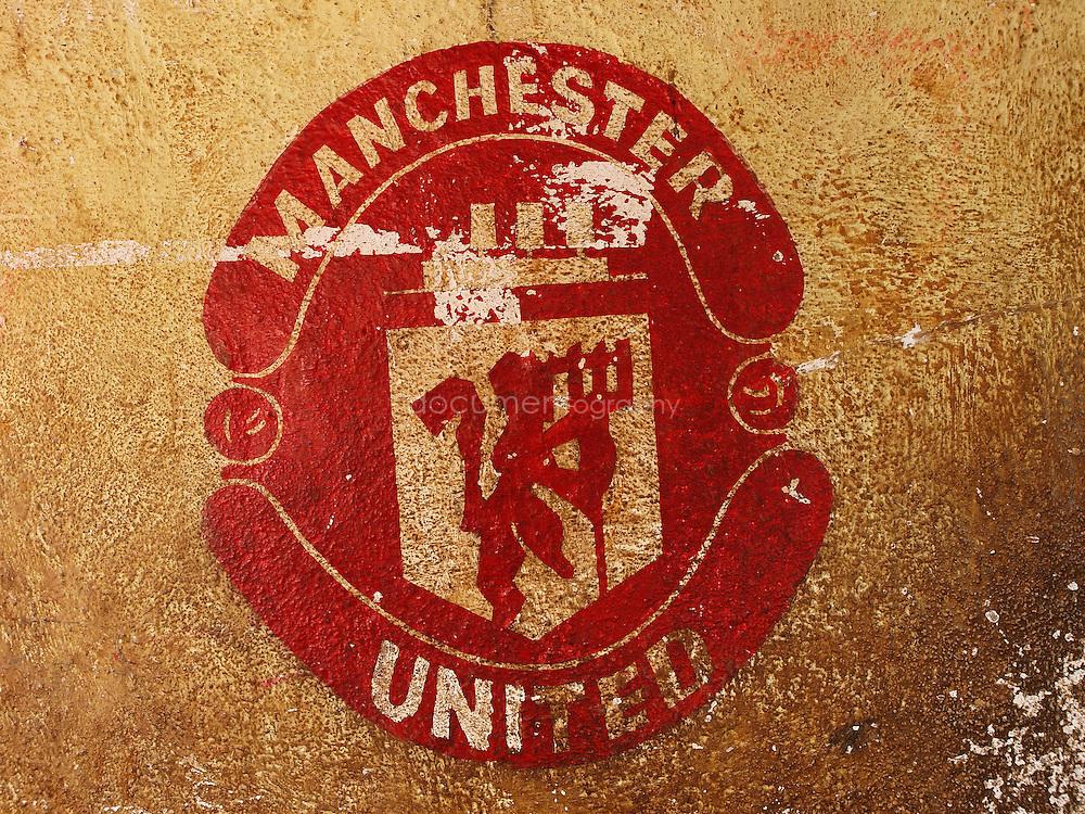 A Manchester stencil on a fan's house, Kroo bay, Freetown, Sierra Leone