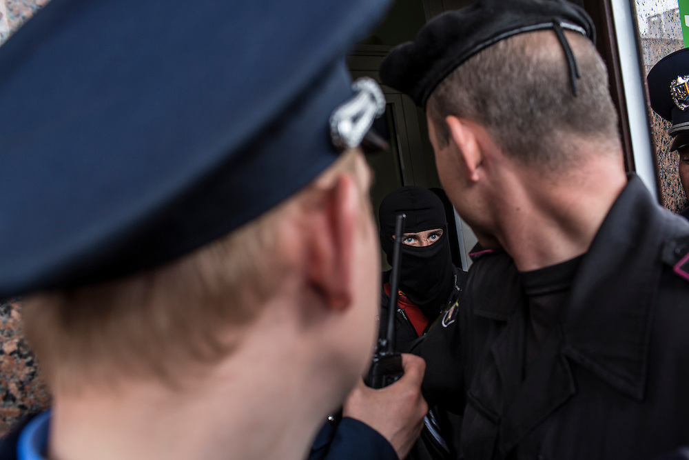 A pro-Russia activist enters a local police station which was taken over by the crowd on Thursday, May 1, 2014 in Donetsk, Ukraine.