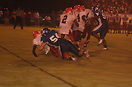 Water Valley's Justin McCammon (54) forces a fumble vs. Coffeeville in Coffeeville, Miss. on Friday, August 24, 2012. Water Valley won.