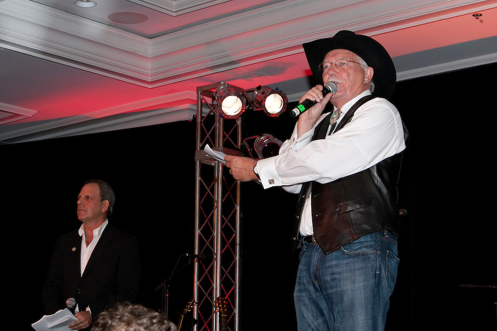 President of the Challenge Aspen Board of Directors Jimmy Yeager and Auctioneer Gary Corbett raise some money for Challenge Aspen.