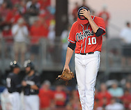 Mississippi's Chris Ellis (10) reacts to walking three straight batters to load the bases in an NCAA Super Regional game in Lafayette, La. on Saturday, June 7, 2014.