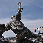 Ty Cobb statue at Comerica Park stands approx. 13 ft tall and is cast in stainless steel. It sits on a granite base and stands with 5 other Detroit Tiger Hall of Fame statues.