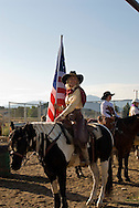 Cowgirl with American Flag before Grand Entry at Cowboy Mounted Shooting, Bozeman Montana
