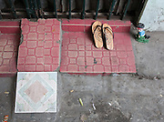 Entrance to House with motorbike ramp and wooden sandals, French Quarter, Hanoi, Vietnam