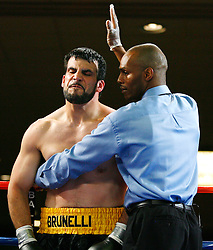 May 9, 2008; Atlantic City, NJ, USA;  2004 US Olympic team captain Devin Vargas (red trunks) knocks out Dave Brunelli (yellow trunks) in the first round of their heavyweight bout at Bally's Ballroom in Atlantic City, NJ.