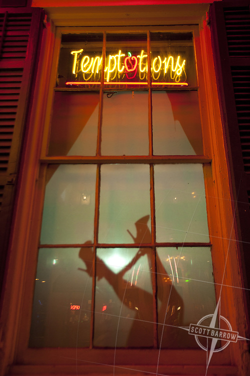 Silhouette of an exotic dancer on Bourbon Street in New ...